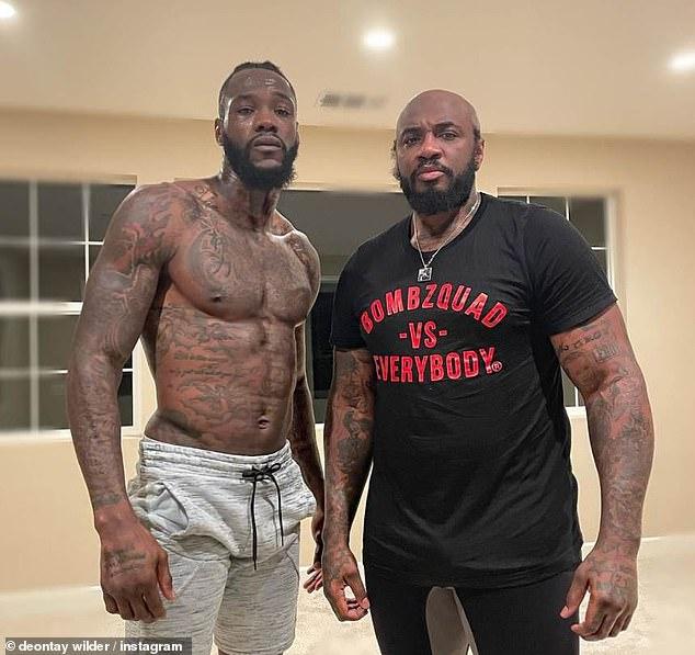 El entrenador de Wilder, Malik Scott (derecha), afirmó que el peso pesado no está interesado en el dinero extra.