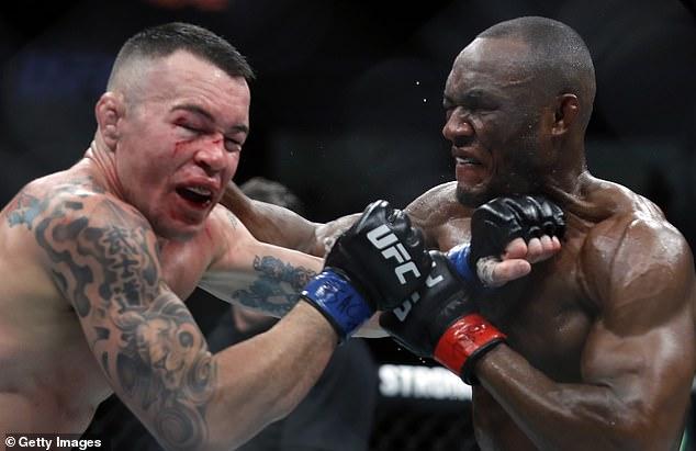 Usman (derecha) le rompió la mandíbula a Colby Covington (izquierda) en su primera defensa en diciembre de 2019